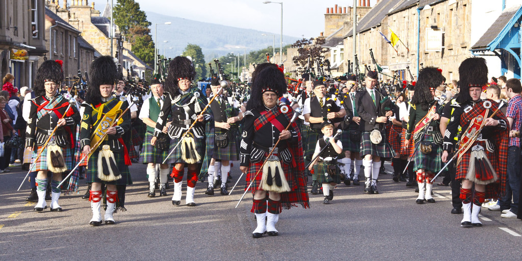 Pipes and Drums marching through Aberlour